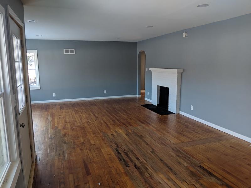 hardwood room with fireplace