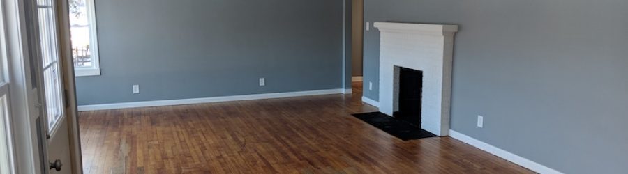 hardwood room with fireplace